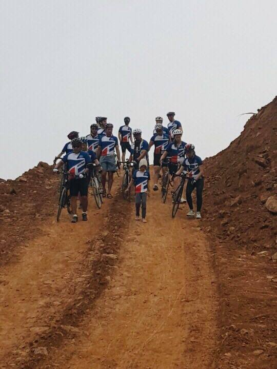Little Charlotte leading the riders down the muddy hill.